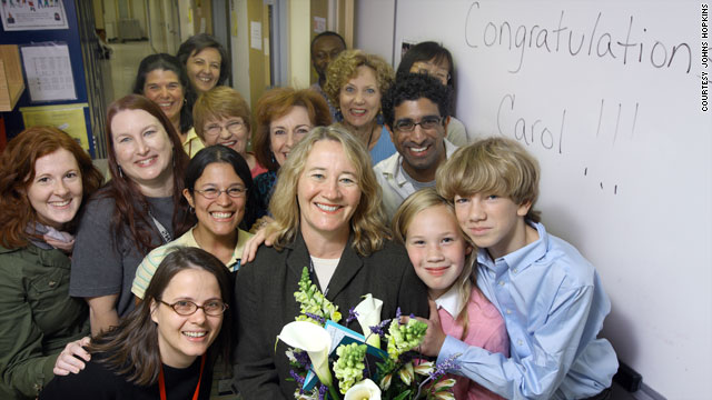 Dr. Carol Greider, center, was feted by her son, daughter and her colleagues at Johns Hopkins School of Medicine on October 5, the day it was announced that she won the Nobel Prize for Medicine.